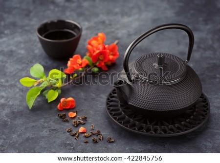 Asian cast iron tea set with green tea. Tea ceremony - stock photo