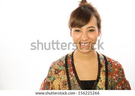 Asian caucasian mixed race young woman smiling face - stock photo