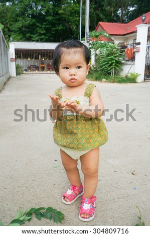 asian child Enjoy Walk and playing outdoors