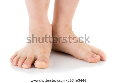 Asian child foot. Studio shot. on white background