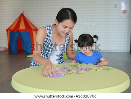 Asian girl playing cards 9