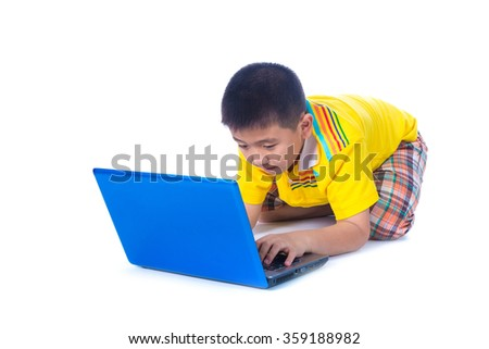 Asian child in yellow t-shirt using a blue laptop, sitting on white background, isolated - stock photo