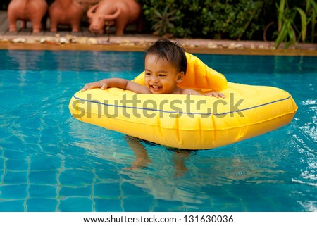 Asian children in swimming pool - stock photo
