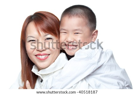 Asian Chinese boy hugs mum isolated on white