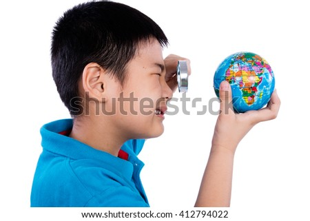 Asian Chinese Boy Looking At Globe Through Magnifying Glass in isolated White Background - stock photo