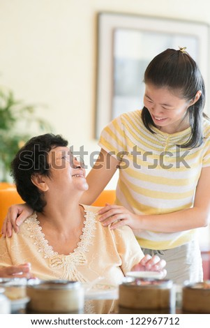 Asian Chinese family interaction inside a restaurant - stock photo