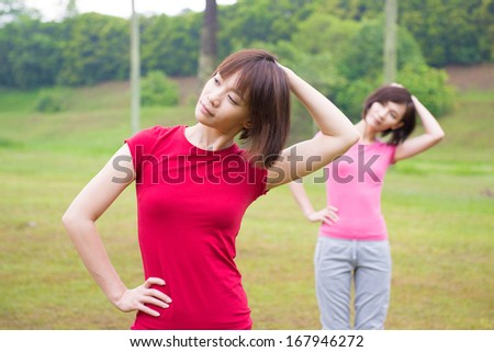 Asian Chinese girls workout outdoor, stretching - stock photo