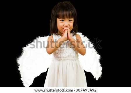 Asian Chinese Little Angel in black background studio shot. - stock photo