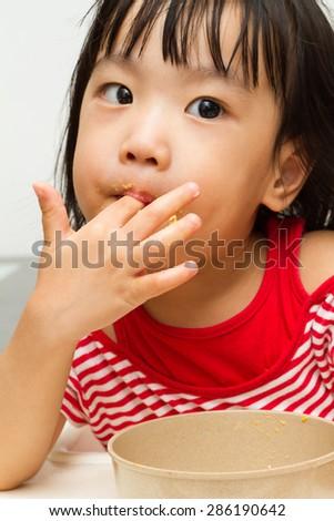 Asian Chinese little girl eating durian fruit - stock photo