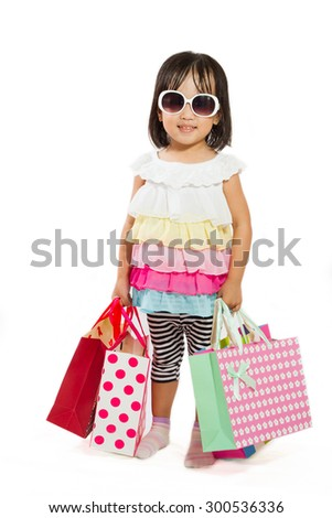Asian Chinese little girl with shopping bag in white isolated background. - stock photo