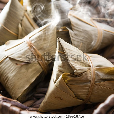 Asian Chinese rice dumplings on basket, fresh with hot steamed smoke - stock photo
