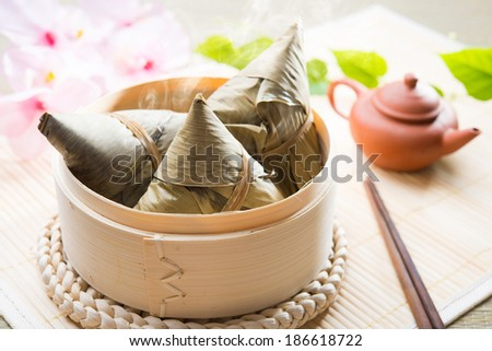 Asian Chinese rice dumplings or zongzi with tea - stock photo