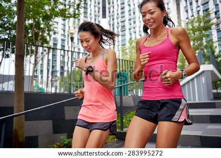 asian chinese sporty women running down stairs outdoors for morning workout - stock photo