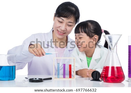 Asian Chinese teacher and little student girl working with test tube in isolated white background