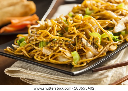 Asian Chow Mein Noodles with Vegetables and Chopsticks - stock photo