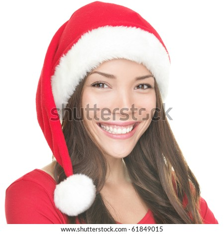 Asian Christmas girl smiling. Portrait of young smiling asian woman wearing Santa hat. Isolated on white background.