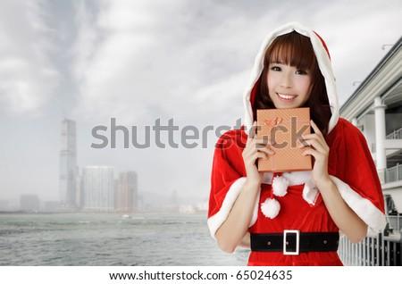 Asian christmas woman holding gift in Hong Kong, Asia. - stock photo