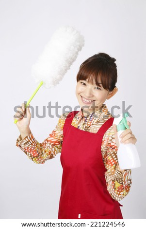 Asian cleaning woman - stock photo