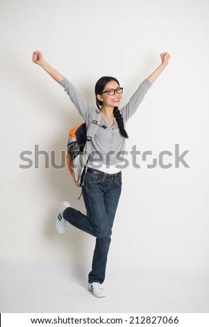 asian college girl celebrating success in joy - stock photo