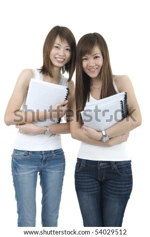 asian college student friends holding book with isolated white background - stock photo