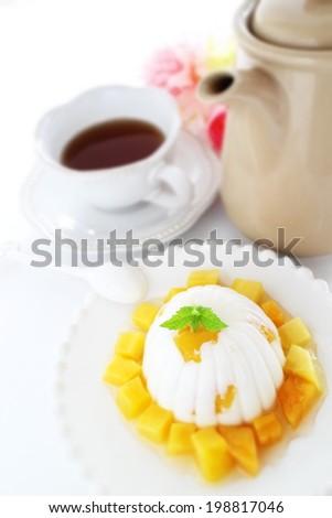 Asian confectionery, mango agar and English tea - stock photo