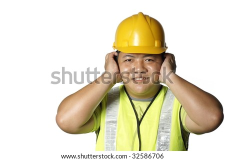 Asian construction worker covering ears