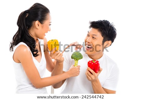 Asian couple eating and living healthy - stock photo