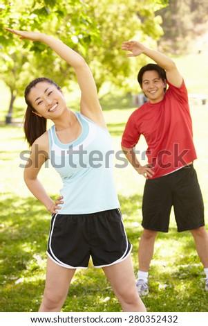 Asian couple exercising - stock photo