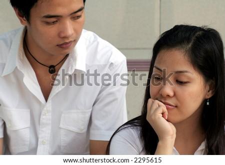 Asian Couple's Quarrel - focus on the girl - stock photo
