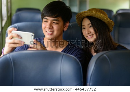Asian couple taking picture
