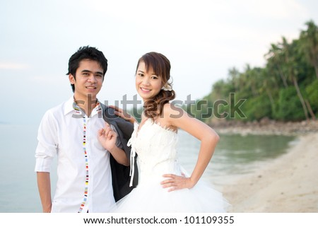 Asian couple with pre wedding sceen out door background.