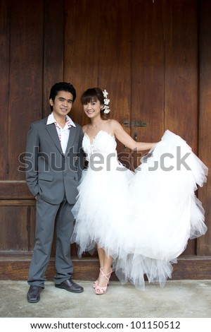 Asian couple with wedding scene out door background.