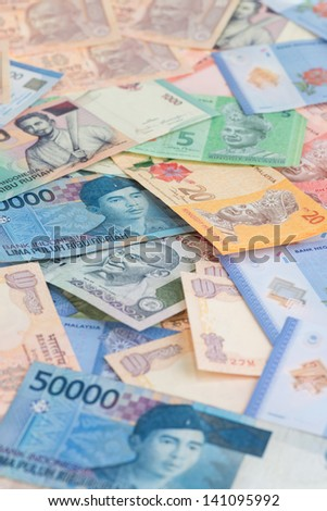 Asian currencies background vertical - stock photo