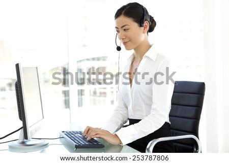 Asian Customer Service Representative - stock photo