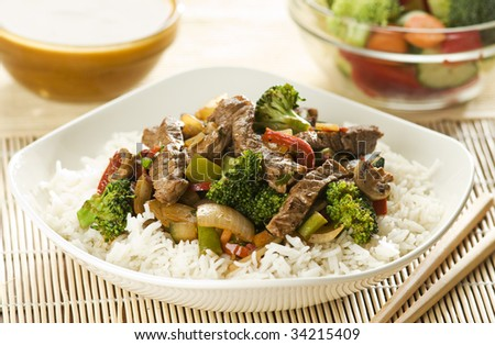 Asian dish with beef, vegetables and curry sauce - stock photo