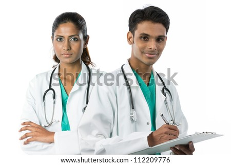 Asian doctor's wearing a green scrubs, white coat and stethoscope. - stock photo