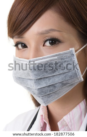 Asian doctor woman wear a surgical mask, closeup portrait. - stock photo