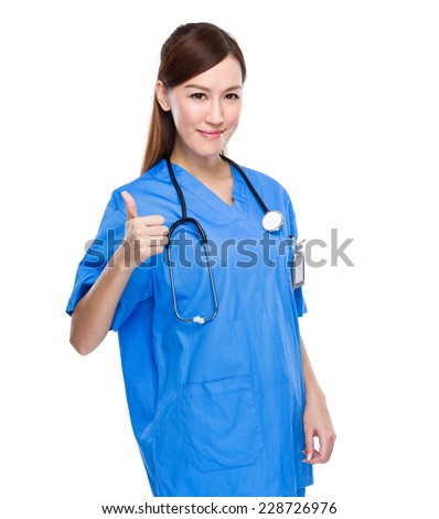 Asian doctor woman with thumb up