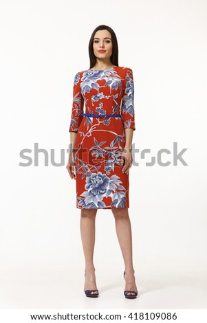 asian eastern brown hair business executive woman with straight hair style in formal party red blue print floral dress high heel shoes going full body length isolated on white - stock photo