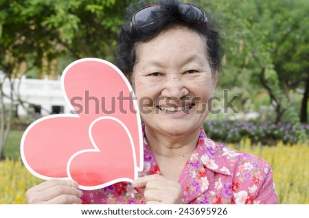 asian elderly at the park - stock photo
