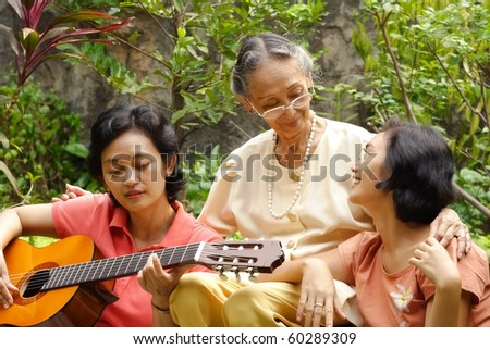 Asian elderly mother relaxing together with her daughter - stock photo