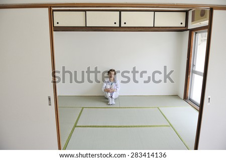 Asian elderly women who are sitting in the Japanese style of the room alone - stock photo