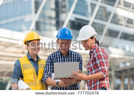 Asian engineers group consult construction on stock photo asian engineers group consult construction on site building working while holding laptop and blueprint paper malvernweather Gallery
