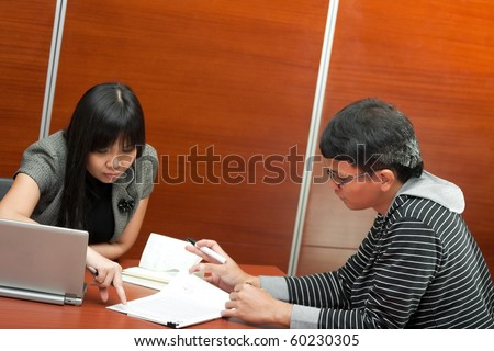 Asian ethnic business people in teamwork meeting at the office - stock photo