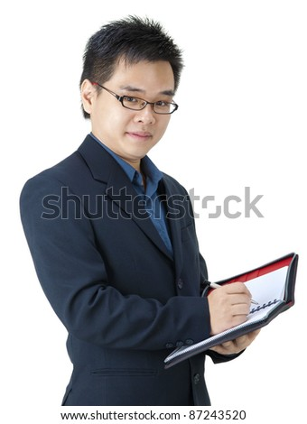 Asian Executive with his diary - stock photo