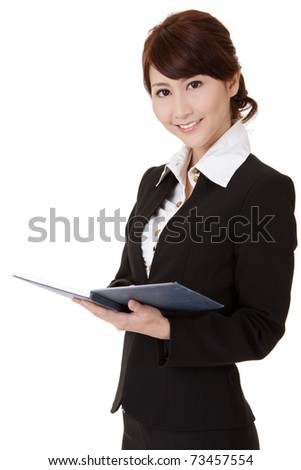 Asian executive woman smiling and looking at you holding book, half length closeup portrait on white background.