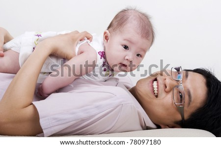 Asian family. Asian father playing with his baby girl - stock photo