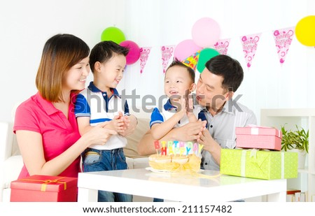 Asian family celebrating birthday - stock photo