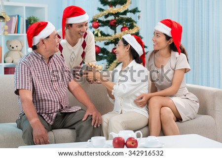 Asian family celebrating Christmas at home - stock photo