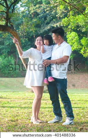 Asian family enjoying outdoor nature - stock photo